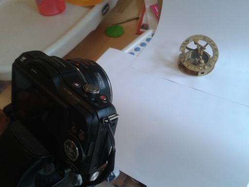 Macro Photography of an Old Navigational Compass using a White Background and Natural Light.