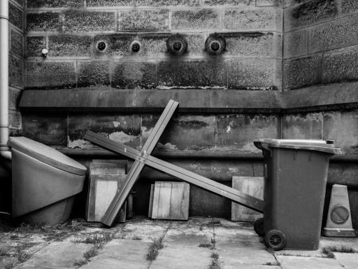 Crucifix Next to the Bin Outside a Church in Belper