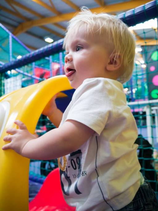Another portrait of my Son in a play center. I used my standard 14mm-42mm kit lens for this shot.
